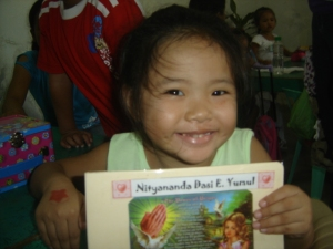 Ananda and her first school notebook